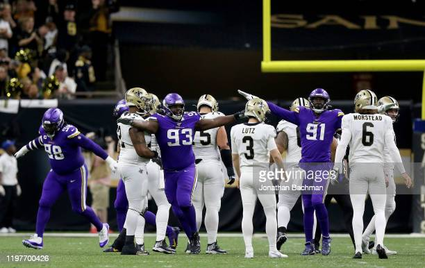 The Minnesota Vikings react to a missed field goal by Wil Lutz of the New Orleans Saints in the NFC Wild Card Playoff game at the Mercedes Benz...