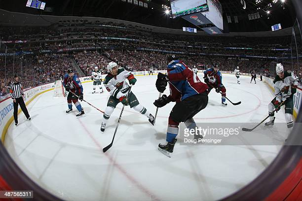 The Minnesota Wild and the Colorado Avalanche battle in Game Seven of the First Round of the 2014 NHL Stanley Cup Playoffs at Pepsi Center on April...
