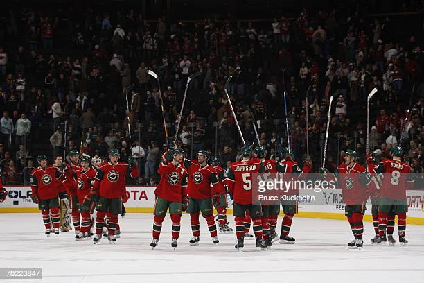 The Minnesota Wild celebrate after defeating the Phoenix Coyotes at Xcel Energy Center on November 28 2007 in Saint Paul Minnesota