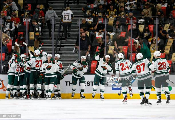 The Minnesota Wild celebrate after Joel Eriksson Ek scored an overtime goal against the Vegas Golden Knights to win Game One of the First Round of...