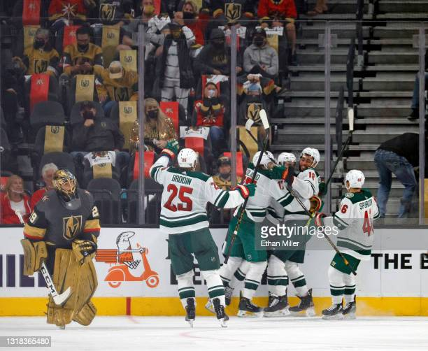 The Minnesota Wild celebrate after Joel Eriksson Ek scored an overtime goal against Marc-Andre Fleury of the Vegas Golden Knights for a 1-0 win in...