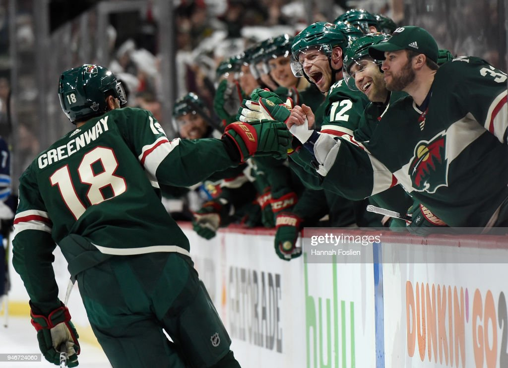 The Minnesota Wild congratulate teammate Jordan Greenway #18 on scoring a goal against the Winnipeg Jets during the second period in Game Three of the Western Conference First Round during the 2018 NHL Stanley Cup Playoffs at Xcel Energy Center on April 15, 2018 in St Paul, Minnesota. The Wild defeated the Jets 6-2.