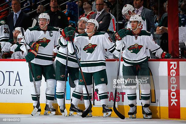 The Minnesota Wild pause during a time out against the Colorado Avalanche at Pepsi Center on October 8 2015 in Denver Colorado The Wild defeated the...