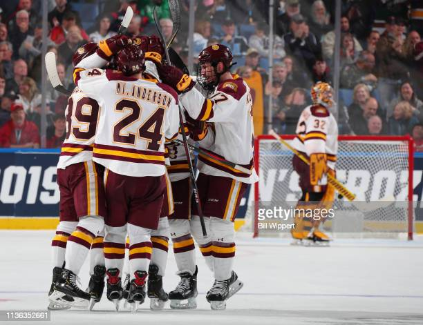 The MinnesotaDuluth Bulldogs celebrate their 41 victory against the Providence Friars during the Division I Men's Ice Hockey Semifinals held at...