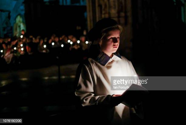 The Minster Choir hold candles as they sing during the Advent Procession at York Minster on December 02 2018 in York England The candlelit service...