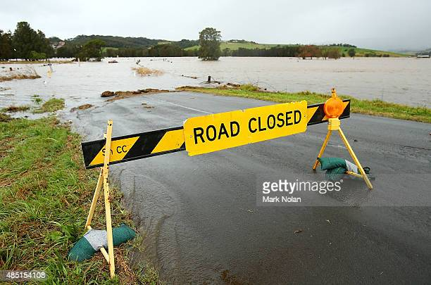 The Minumurra River floods farm land and closes Swamp road on August 25 2015 in Jamberoo Australia Residents downstreamm of the Jerra dam which feeds...
