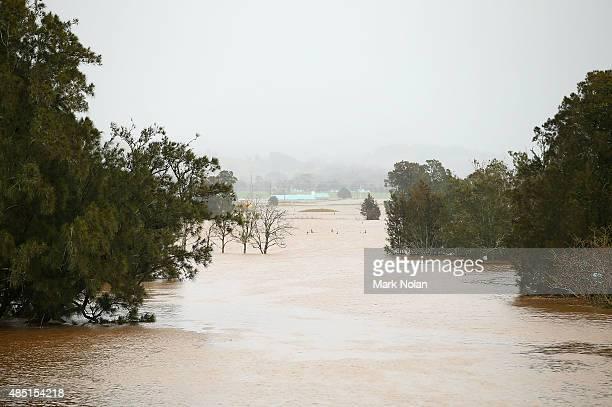 The Minumurra River floods farm land near Kiama Downs on August 25 2015 in Kiama Australia Residents downstreamm of the Jerra dam which feeds into...