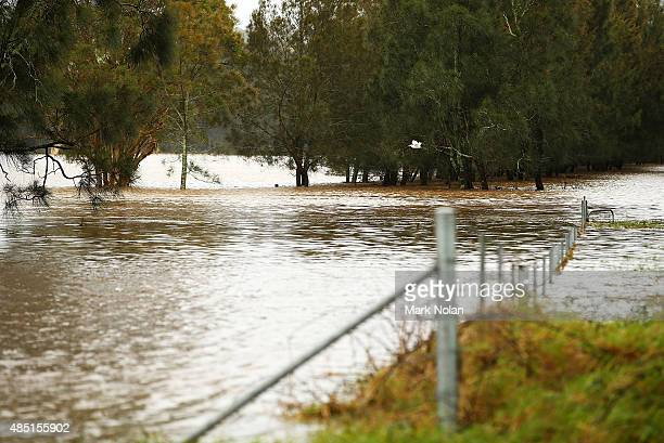 The Minumurra River floods farm land on August 25 2015 in Jamberoo Australia Residents downstreamm of the Jerra dam which feeds into the river have...
