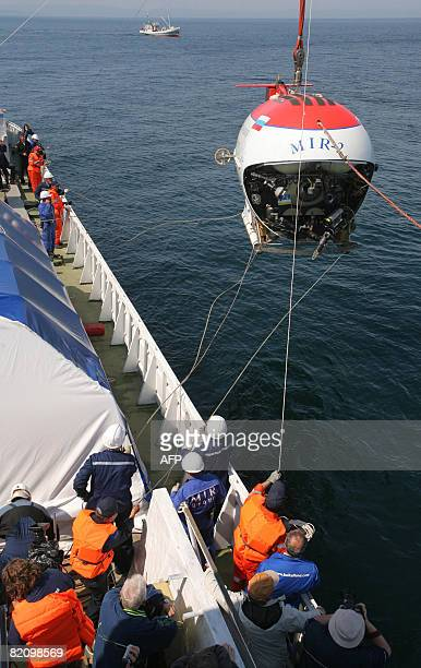 The Mir2 minisubmarine is lowereded into the waters of Russia's lake Baikal on July 29 2008 A Russian minisubmarine dive to the bottom of Lake Baikal...