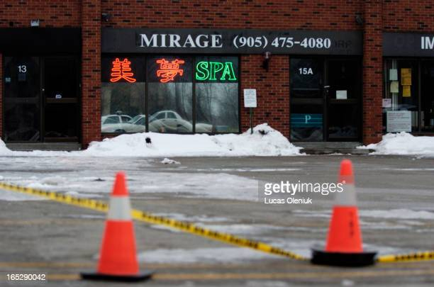 The Mirage Spa which operates as a massage parlour near Warden and Steeles has been closed off by police due to possible links with the three bodies...