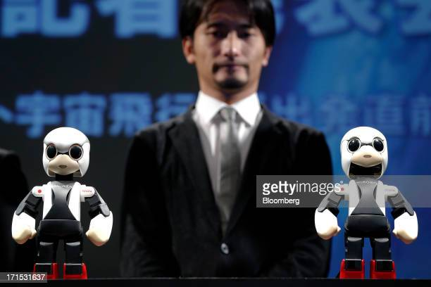 The Mirata humanoid communication robot, left, and the Kirobo humanoid communication robot, right, jointly developed by Dentsu Inc., University of...