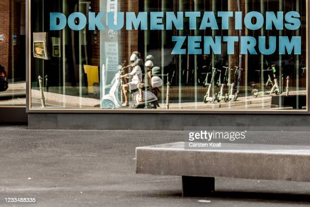 The mirror image of a scooter is seen in the window of the new Documentation Center for Displacement, Expulsion and Reconciliation on June 16, 2021...