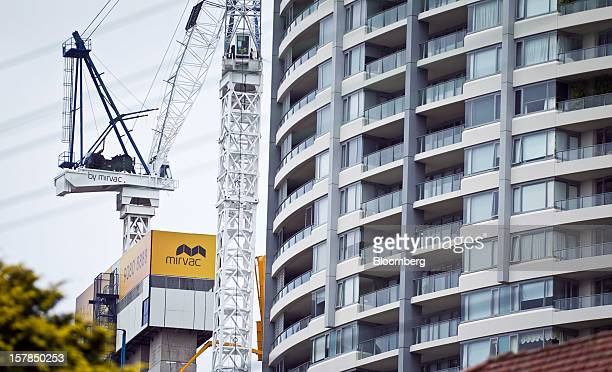 The Mirvac Group logo is displayed on a crane at the construction site of a residential apartment block left in Sydney Australia on Friday Dec 7 2012...