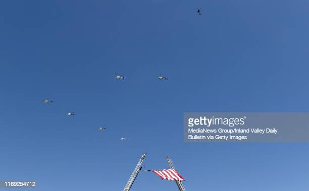 The missing man formation flies over after memorial services for California Highway Patrol Officer Andre Moye Jr at Harvest Christian Fellowship...