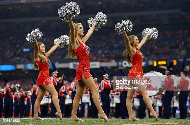 The Mississippi Rebels cheerleaders perform before the first quarter against the Oklahoma State Cowboys during the Allstate Sugar Bowl at...