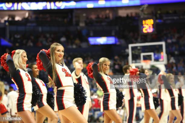 The Mississippi Rebels cheerleaders perform during a Southeastern Conference Tournament game between the Alabama Crimson Tide and Mississippi Rebels...