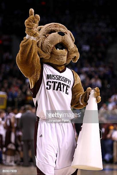 The Mississippi State Bulldogs mascot performs during a break in the game against the Washington Huskies during the first round of the NCAA Division...
