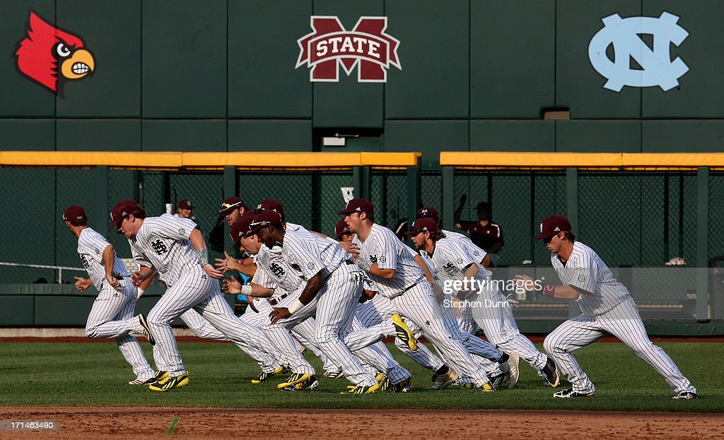 The Mississippi State Bulldogs run in the outfield to warm up before playing the UCLA Bruins during game one of the College World Series Finals on June 24, 2013 at TD Ameritrade Park in Omaha, Nebraska. UCLA won 3-1.