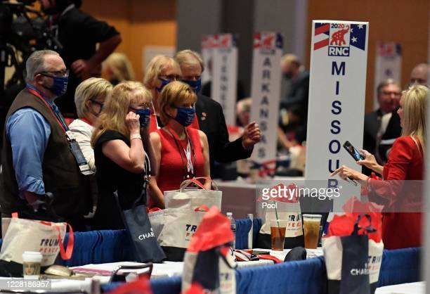 The Missouri delegation takes a group photo on the first day of the Republican National Convention at the Charlotte Convention Center on August 24,...