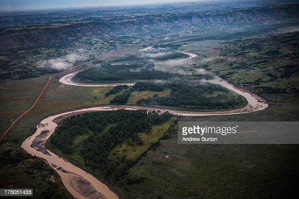 The Missouri River and the Badlands region is seen in an aerial view in the early morning hours of July 30 2013 near Watford City North Dakota North...