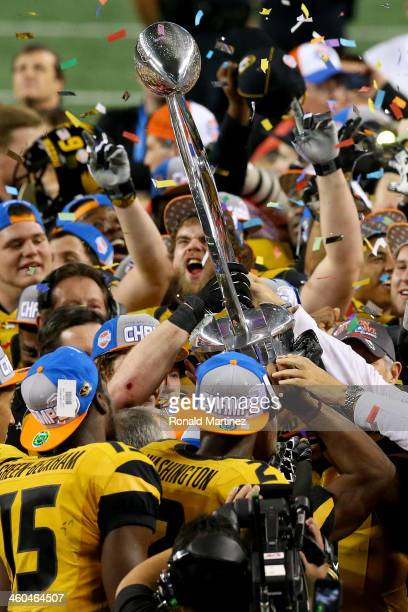 The Missouri Tigers celebrate after the Tigers 41-31 victory against the Oklahoma State Cowboys during the AT&T Cotton Bowl on January 3, 2014 in...
