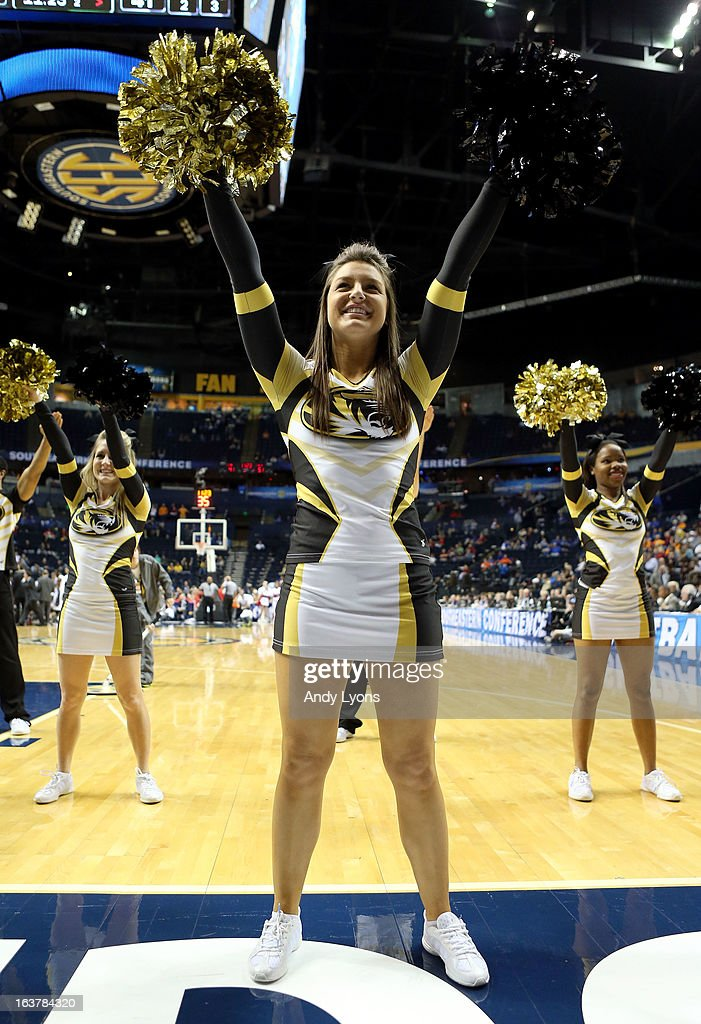 The Missouri Tigers cheerleaders perform during the game against the Ole Miss Rebels during the quarterfinals of the SEC Baketball Tournament at Bridgestone Arena on March 15, 2013 in Nashville, Tennessee.