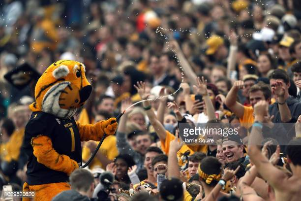 The Missouri Tigers mascot Truman sprays fans with water prior to the game against the Wyoming Cowboys at Faurot Field/Memorial Stadium on September...