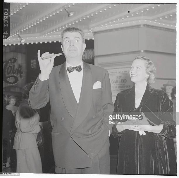 The missus looks amused as Ken Murray does tricks with his cigar Ken's type of entertainment would be ideally suited for Vaudeville