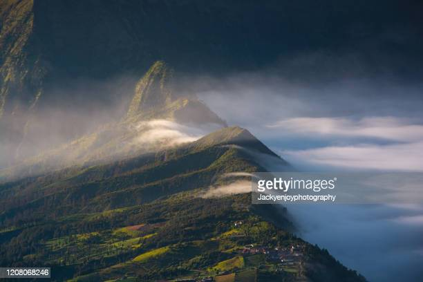 the mist at cemoro lawang village at mount bromo, indonesia - bromo crater stock pictures, royalty-free photos & images