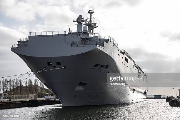 The Mistral class helicopter carrier Vladivostok sits moored in the dock at the STX France SA shipyard a unit of STX Europe AS in SaintNazaire France...