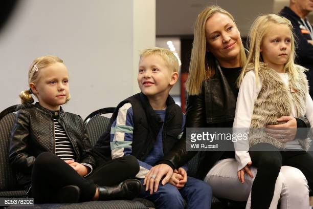 The Mitchell family look on as Sam Mitchell speaks to the media announcing his retirement from playing at the end of the home and away season during...