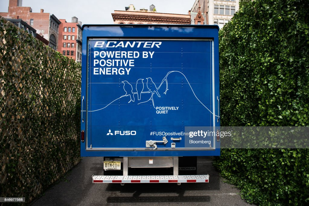 The Mitsubishi Fuso eCanter truck is displayed during a launch event in New York, U.S., on Thursday, Sept. 14, 2017. The Daimler AG unit unveiled the new Fuso eCanter, an electric light-duty truck produced under its Mitsubishi Fuso brand. The latest version has a range of 60 to 80 miles (97 to 129 kilometers) between charges, depending on body, load and usage. Photographer: Mark Kauzlarich/Bloomberg via Getty Images