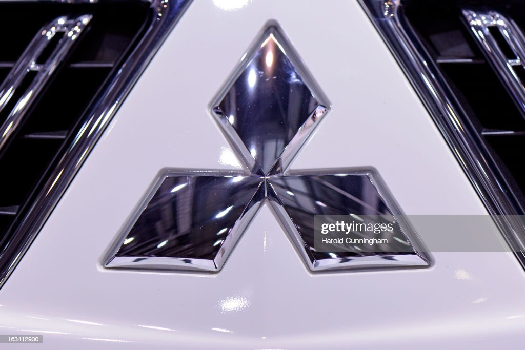 The Mitsubishi logo is seen during the 83rd Geneva Motor Show on March 6, 2013 in Geneva, Switzerland. Held annually with more than 130 product premiers from the auto industry unveiled this year, the Geneva Motor Show is one of the world's five most important auto shows.