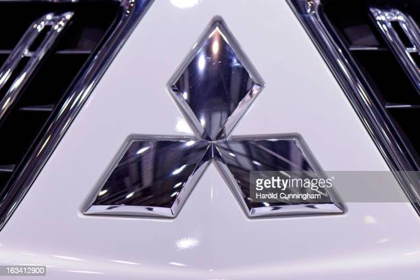 The Mitsubishi logo is seen during the 83rd Geneva Motor Show on March 6 2013 in Geneva Switzerland Held annually with more than 130 product premiers...