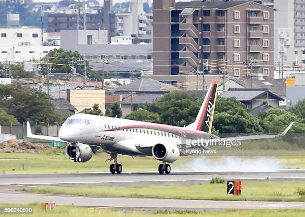 The Mitsubishi Regional Jet, a new passenger jet being developed by Japan's Mitsubishi Aircraft Corp., touches down at Nagoya airport in Aichi...