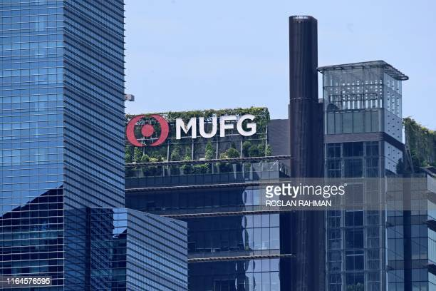 The Mitsubishi UFJ Financial Group bank logo is displayed on a building in Singapore on August 29, 2019.