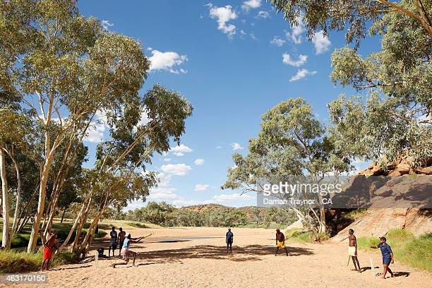The Miwatj Dolphins from Arnhem Land in the Northern Territory play cricket in the dry Todd River during the 20415 Imparja Cup on February 11 2015 in...