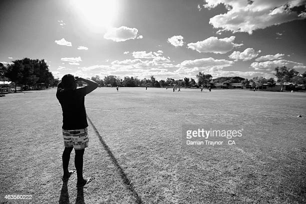 The Miwatj Dolphins from Arnhem Land in the Northern Territory play cricket during the 20415 Imparja Cup on February 13 2015 in Alice Springs...