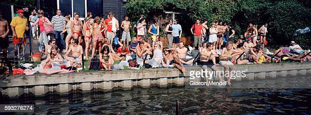 The mixed pond on Hampstead Heath is crowded to capacity on a hut summer day Hampstead Heath is a public open space in the north of London It 791...