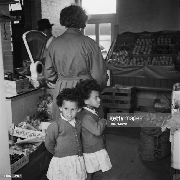 The mixed race Long family of Olyffe Avenue in Welling, Kent, July 1960. Mother Lydia Long goes shopping for treats with two of her adopted children,...