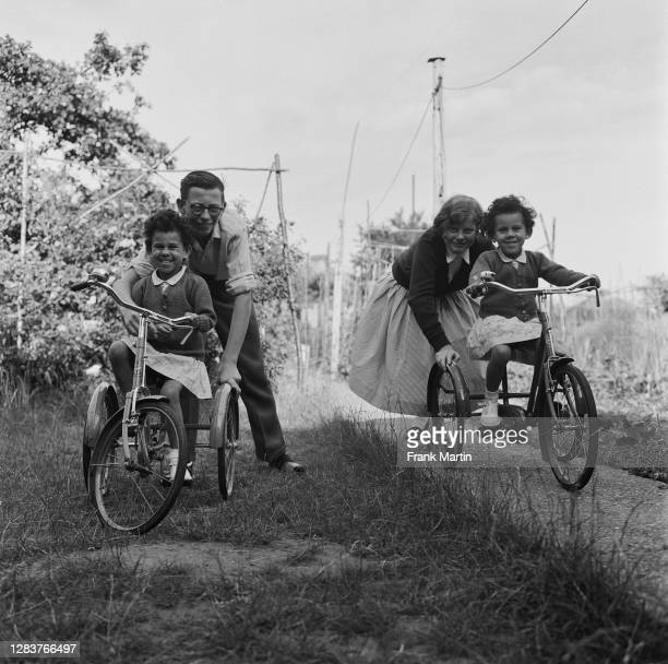The mixed race Long family of Olyffe Avenue in Welling, Kent, July 1960. Joan and Ian play with their adopted sisters, twins Mitch and Frankie.