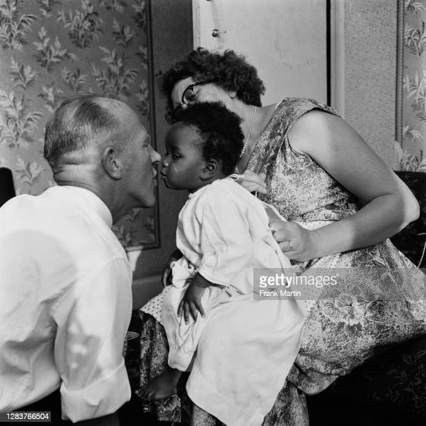 The mixed race Long family of Olyffe Avenue in Welling, Kent, July 1960. Parents Lydia and William Long playing with their adopted daughter Kim.