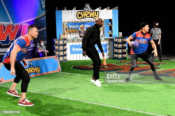 The Miz, Sara Walsh, Chad Ochocinco, and Diplo participate in a celebrity challenge at The SHAQ Bowl for Super Bowl LV on February 07, 2021 in Tampa,...