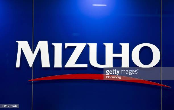 The Mizuho Financial Group Inc. Logo is displayed in the Mizuho Bank Ltd. Automated teller machine area at the company's headquarters in Tokyo,...