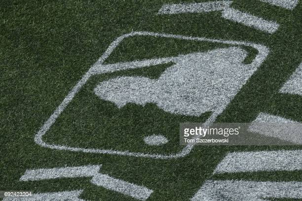 The MLB logo decal appears on the turf field as the league promotes its Play Ball campaign during the Toronto Blue Jays MLB game against the New York...