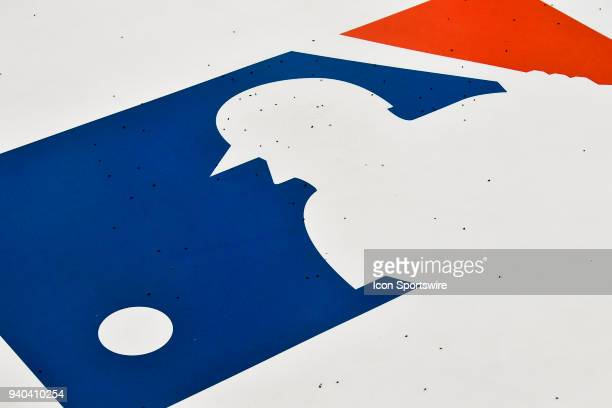 The MLB Logo on the batter's circle with the rubber turf granules on it before the MLB seasonopener game between the New York Yankees and the Toronto...