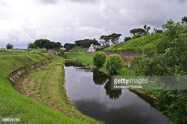 The moat surrounding the walls of the Friulian town also known as the starshaped city In the distance the Aquileia Gate one of the three gates of the...