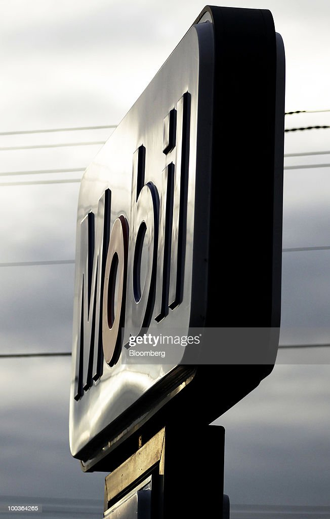 The Mobil logo is displayed at an Exxon Mobil Corp. gas station in Sydney, Australia, on Monday, May 24, 2010. 7-Eleven Australia is close to acquiring most of Exxon Mobil Corp's local filling stations, the Australian newspaper reported on its website on May 19, without saying where it got the information. Photographer: Ian Waldie/Bloomberg via Getty Images