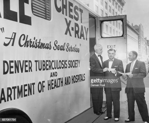 The mobile chest Xray unit opens a fourday stand at the California St entrance to The Denver Post building with Richard Batterton acting mayor first...