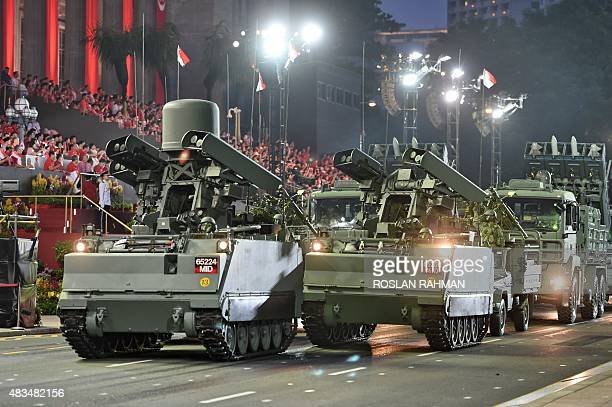 The mobile column from the Singapore Armed Forces takes part in a parade during Singapore's 50th National day anniversary celebration at the Padang...